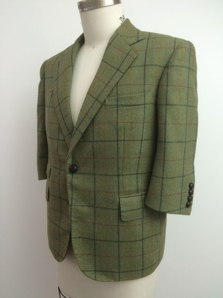 green tweed jacket